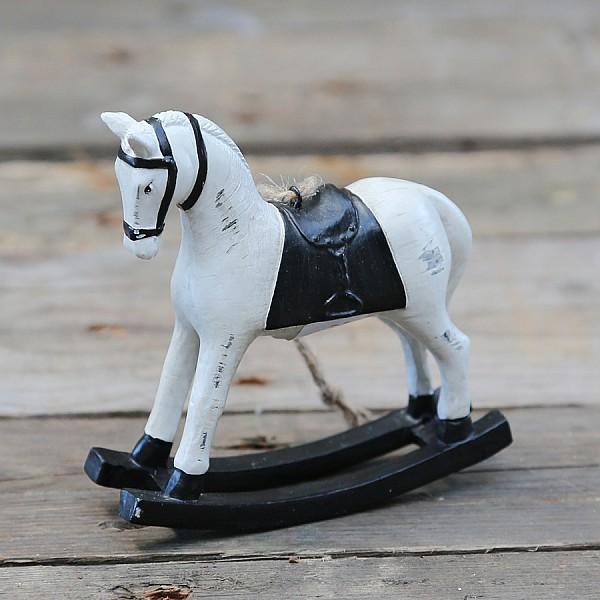 Gunghäst med svart sadel