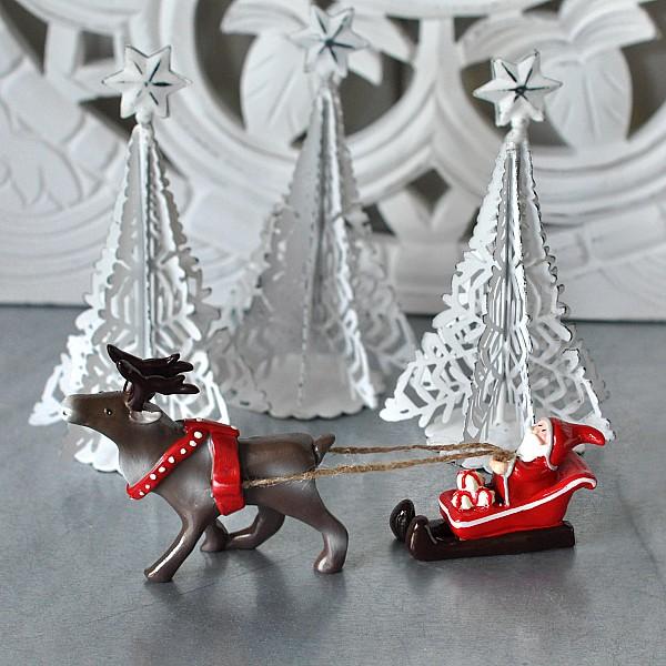 Jultomte Tomtesson på släde
