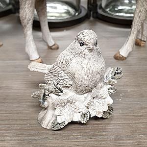 Vinterfågel på gren